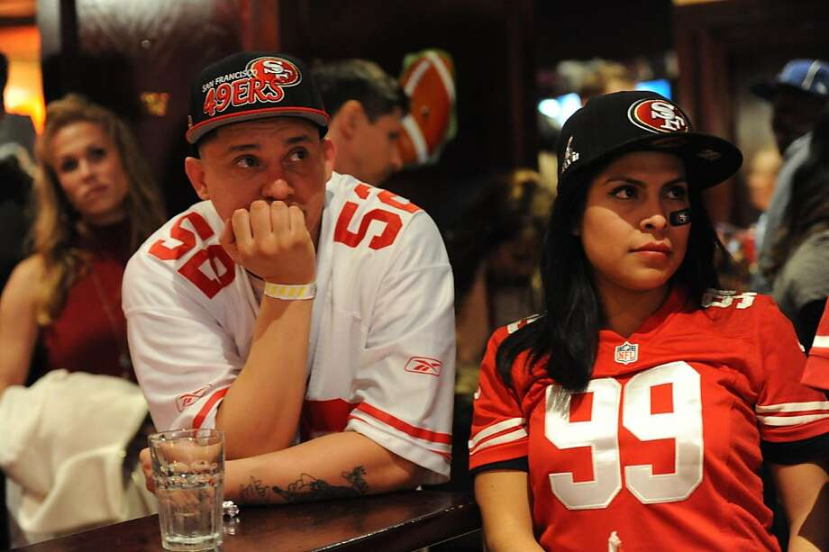 Marvin Solis and Melissa Ortiz are seen at Jillian's in San Francisco after the Baltimore Ravens beat the San Francisco 49ers in the Super Bowl  on February 3, 2013. Photo: Susana Bates, Special To The Chronicle