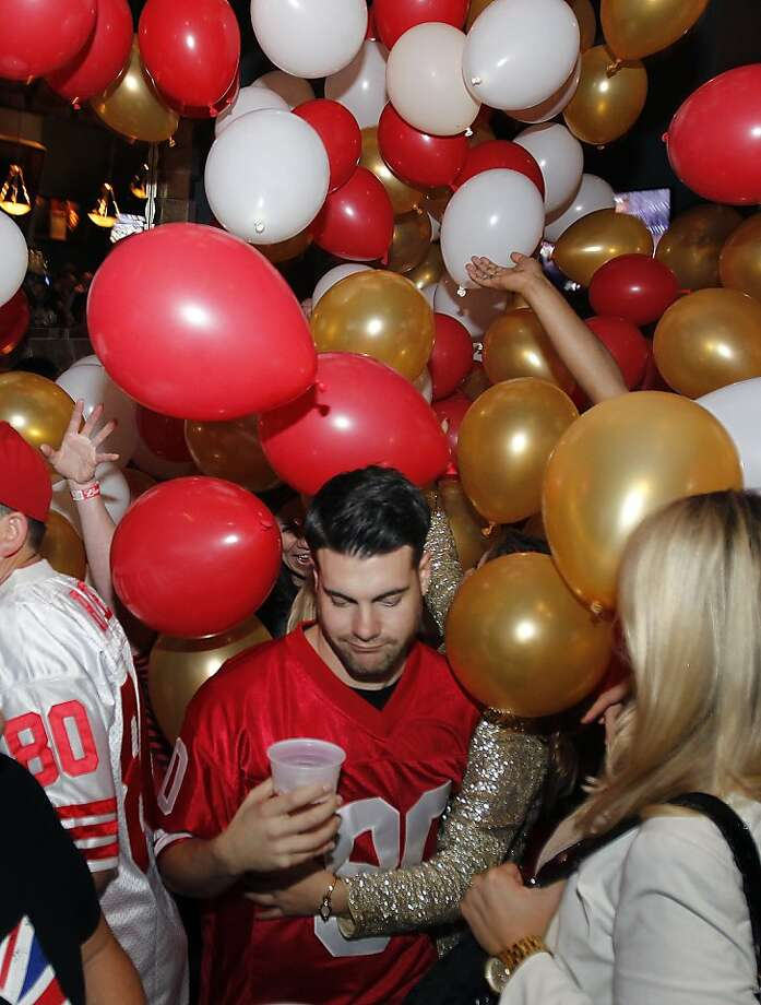 Even the 49ers lost to the Baltimore Ravens, balloons were dropped on fans, including a disappointed Chase Swedelson (center), at the Amante club in San Francisco, Calif. on Sunday, Feb. 3, 2013. Photo: Paul Chinn, The Chronicle