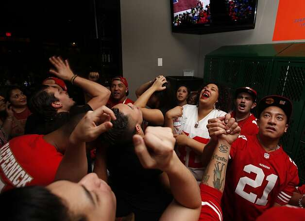 The crowd of San Francisco 49er fans reacts after the  San Francisco 49er lose to the Baltimore Ravens, 34-31, in the Super Bowl, Sunday Feb. 3, 2013, at the Hi Top, San Francisco's first gay sports bar,  San Francisco, Calif. Photo: Lacy Atkins, The Chronicle