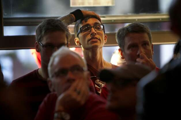 San Francisco 49er fans react at the 49ers lose the ball and the Raven score in the second half of the Super Bowl, Sunday Feb. 3, 2013 at the Hi Top Bar in San Francisco, Calif. Photo: Lacy Atkins, The Chronicle
