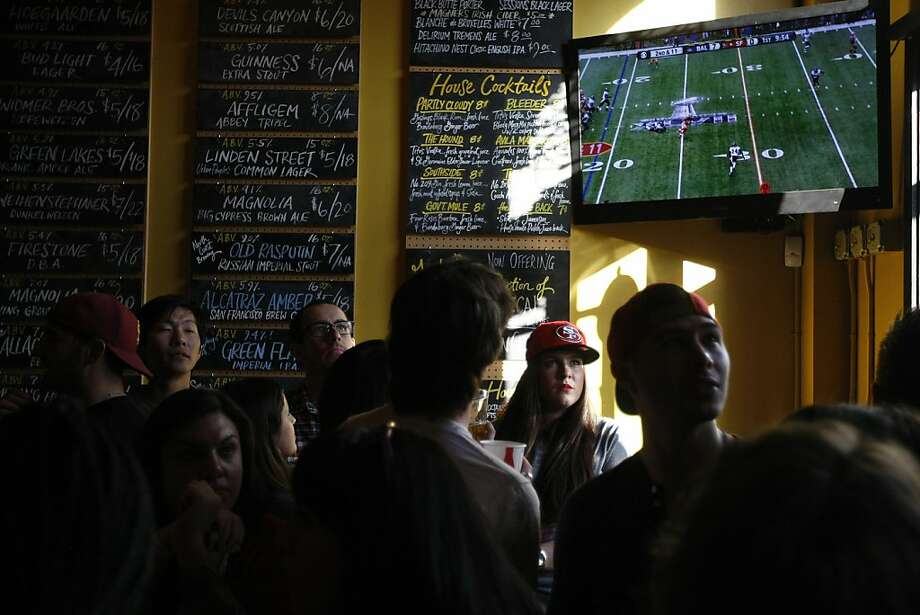 Natalie Lehmann watches the Super Bowl at Giordano Bros. on 16th St. Sunday Feb. 3.  Many 49ers fans took to the Mission District to watch the Super Bowl. Photo: James Tensuan, The Chronicle