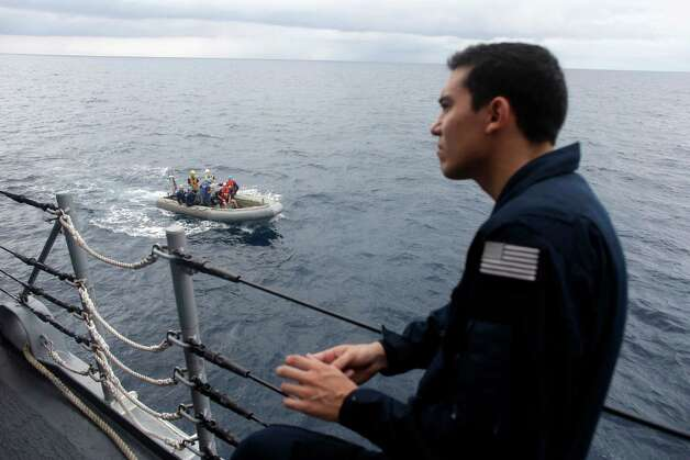 In this Thursday, Oct. 11, 2012 photo a U.S. Coast Guard officer watches as a RHIB boat returns to the USS Underwood after participating in drug interdiction training exercises while patrolling in international waters near Panama. In the most expensive initiative in Latin America since the Cold War, the U.S. has militarized the battle against drug traffickers, spending more than $20 billion in the past decade.  U.S. Army troops, Air Force pilots and Navy ships outfitted with Coast Guard counternarcotics teams are routinely deployed to chase, track and capture drug smugglers. Photo: Dario Lopez-Mills