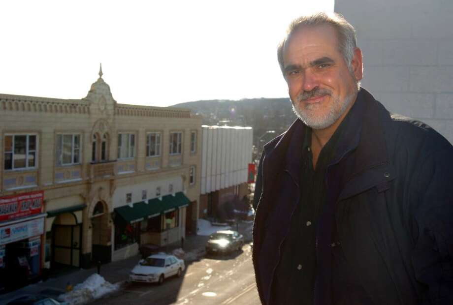 """Markanthony Izzo, of Derby, stands on the parking garage over looking Derby's Elizabeth Street and city hall which will be the backdrop for the film """"Prisoners"""" which will be filming in Derby and Shelton. Photo: Autumn Driscoll / Connecticut Post"""