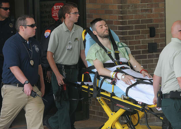 Handcuffed to the stretcher, John Wesley Nero was released from Christus St. Elizabeth Hospital and was transported to jail. Nero is said to be the driver of the car that killed Beaumont Police Officer Bryan Hebert on July 8. Guiseppe Barranco/The Enterprise