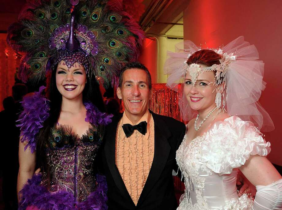 "From left: Hannah Kubiak, Scott Sims and Kasi Kubiak at the Fresh Arts "" Ball and Chain Gala"" at the Winter Street Studios Friday Feb. 01, 2013.(Dave Rossman/ For the Chronicle) Photo: Dave Rossman, For The Houston Chronicle / © 2013 Dave Rossman"