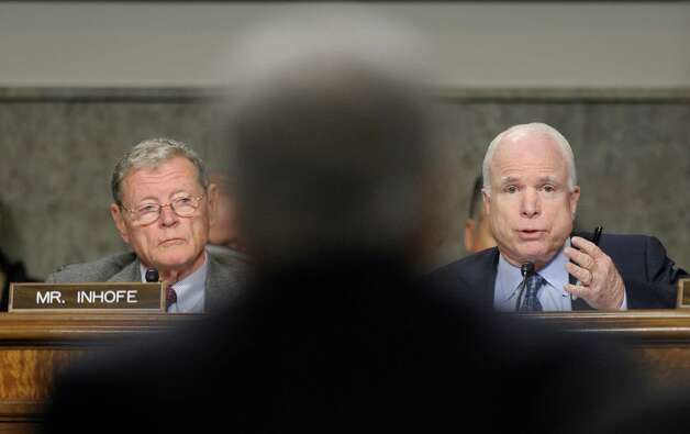 Sen. Jim Inhofe (left), R-Okla., seen during Chuck Hagel's confirmation hearing, is the ranking Republican on the Senate Armed Services Committee. Photo: Susan Walsh, Associated Press / AP