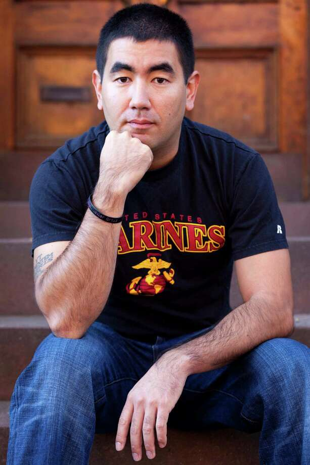 Marine Capt. Timothy Kudo, a graduate student at New York University, deployed to Iraq in 2009 and to Afghanistan from 2010 to 2011.   Photo: John Minchillo, Associated Press / FR170537 AP