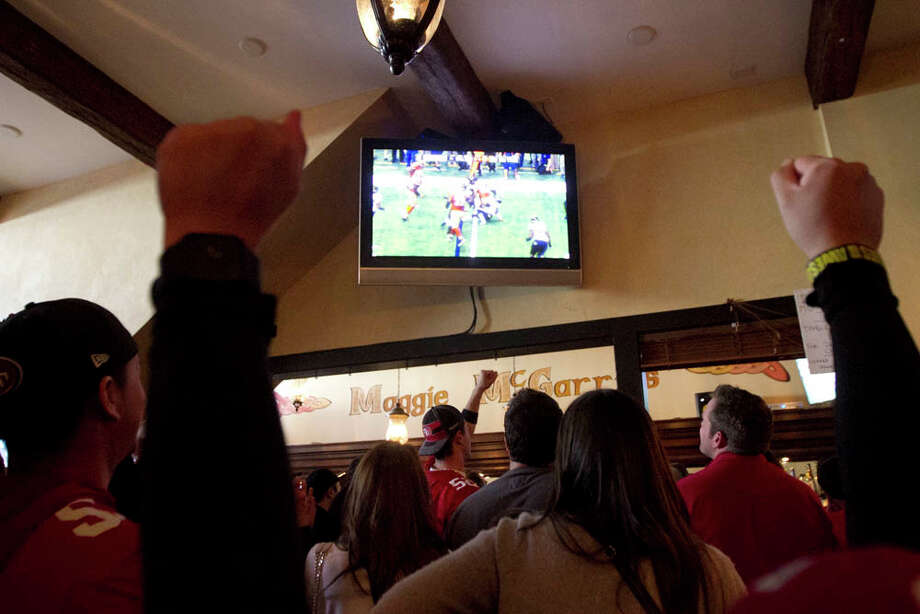 Fans react while watching the Super Bowl at Maggie McGarry's on Grant St. in San Francisco. Photo: SF Gate / Douglas Zimmerman