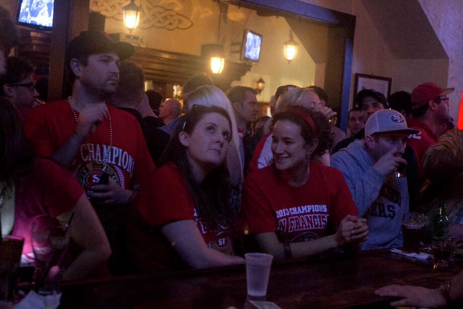 Fans react to the blackout during the game while watching the Super Bowl at Maggie McGarry's on Grant St. in San Francisco. Photo: SF Gate / Douglas Zimmerman