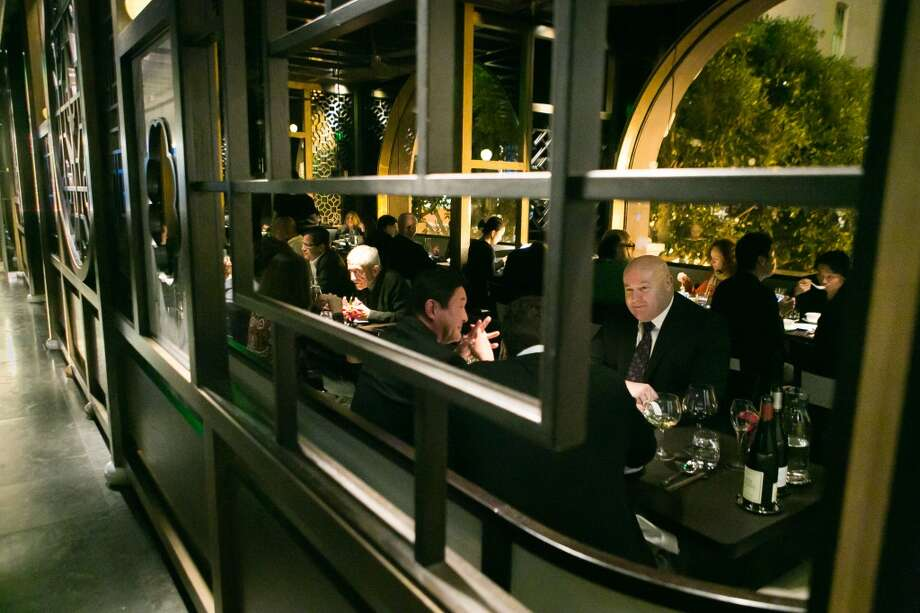 Whether locals, who are traditionally pretty tough on outsiders, will embrace the place in the long run is yet to be determined, but for now it's a coveted reservation ... At Hakkasan diners are clearly paying for much more than the food, which ultimately takes a supporting role to the atmosphere and service.