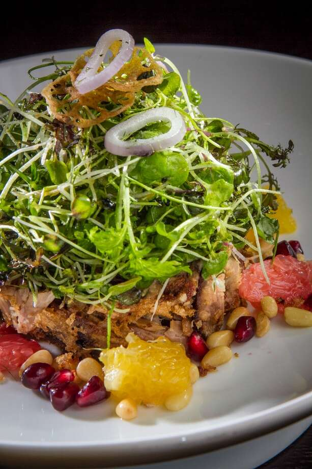 One of the best dishes in this category - and, at $28, the most expensive - is the duck salad, a symphonic blend of sweet and tangy, with bits of crisp fried duck playing off pomegranates, grapefruit, orange, shallots, pine nuts and small peppery greens.