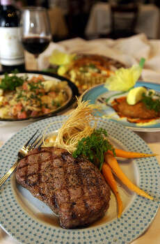 "The Houston Street Bistro has a ""Full Monty"" a 12 oz. Ribeye Steak.  www.houstonstbistro.com Photo: KEVIN GEIL, SAN ANTONIO EXPRESS-NEWS / SAN ANTONIO EXPRESS-NEWS"