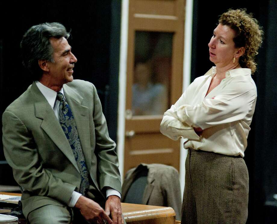 "Belinda Harolds, right, rehearses for a production of the David Mamet play, ""Glengarry Glen Ross,"" with fellow cast member Roger Alvarez, Monday, Jan. 28, 2013, at the Sheldon Vexler Theatre in San Antonio. Photo: Darren Abate, Darren Abate/For The Express-New"