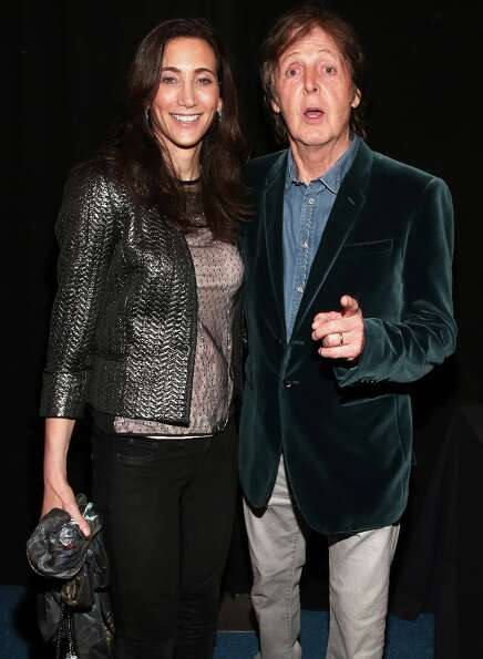 Paul McCartney (R) and Nancy Shevell attend DIRECTV Super Saturday Night Featuring Special Guest Jus