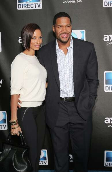 Nicole Murphy and Michael Strahan attend DIRECTV Super Saturday Night Featuring Special Guest Justin