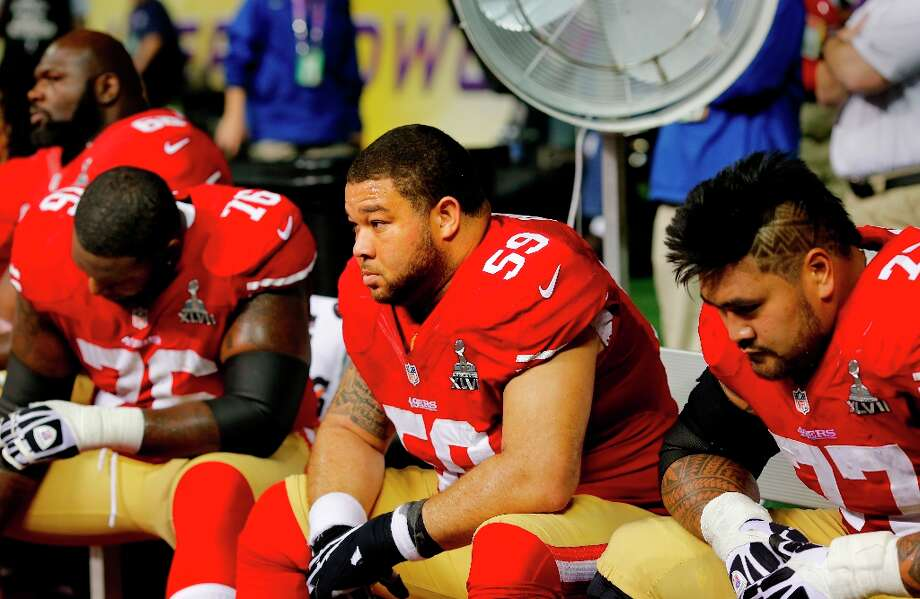 During the lights out stage of the game, with the 49ers down by two touchdowns, Mike Iupati (right), center Jonathan Goodwin and Anthony Davis (76) sat on the bench. The Baltimore Ravens defeated the San Francisco 49ers in Super Bowl XLVVII 34-31 Sunday February 3, 2013. Photo: Brant Ward, The Chronicle / ONLINE_YES