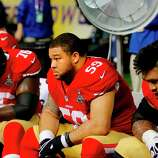 During the lights out stage of the game, with the 49ers down by two touchdowns, Mike Iupati (right), center Jonathan Goodwin and Anthony Davis (76) sat on the bench. The Baltimore Ravens defeated the San Francisco 49ers in Super Bowl XLVVII 34-31 Sunday February 3, 2013.