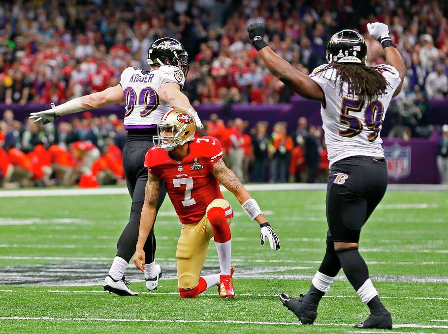 Ravens Paul Kruger and Danell Ellerbe celebrate as the 49ers quarterback Colin Kaepernick watches his pass to teammate Michael Crabtree falls incomplete on their last play of the game for San Francisco, as the San Francisco 49ers fall to the Baltimore Ravens 34-31 in Superbowl XLVII at the Mercedes-Benz Superdome in New Orleans, La. on Sunday Feb. 3, 2013. Photo: Michael Macor, The Chronicle / ONLINE_YES