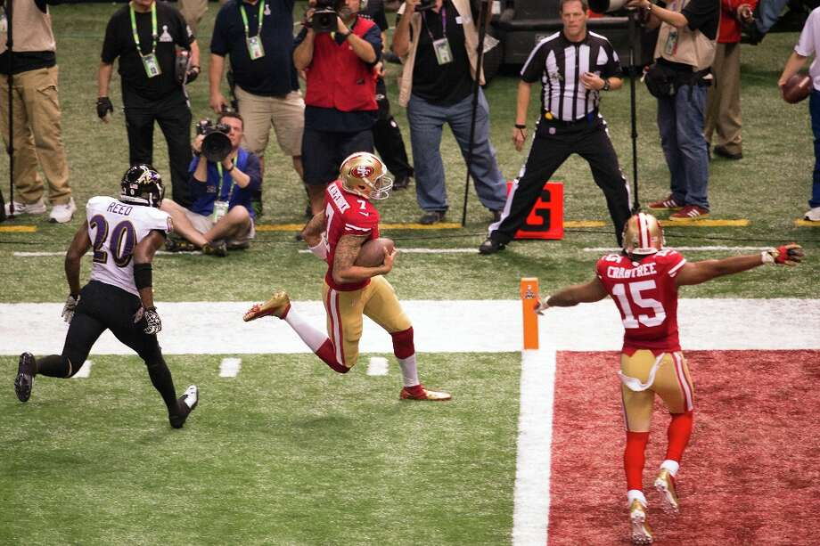 San Francisco 49ers quarterback Colin Kaepernick scores on a 15-yard touchdown run during the fourth quarter of Super Bowl XLVII against the Baltimore Ravens at the Mercedes-Benz Superdome on Sunday, Feb. 3, 2013, in New Orleans. Photo: Smiley N. Pool, Chronicle / ONLINE_YES