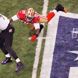 Baltimore Ravens quarterback Joe Flacco (5) slips away from San Francisco 49ers outside linebacker Aldon Smith (99) during the second half of Super Bowl XLVII at the Mercedes-Benz Superdome on Sunday, Feb. 3, 2013, in New Orleans.