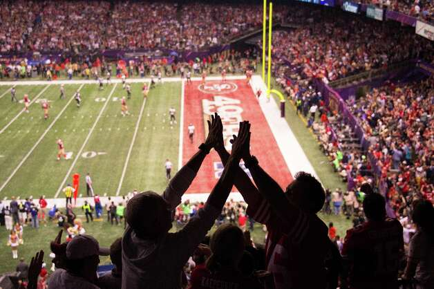 San Francisco 49ers fans celebrate a 15-yard touchdown run by quarterback Colin Kaepernick during the fourth quarter of Super Bowl XLVII against the Baltimore Ravens at the Mercedes-Benz Superdome on Sunday, Feb. 3, 2013, in New Orleans. Photo: Smiley N. Pool, Chronicle / © 2013  Houston Chronicle