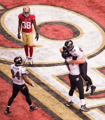 Baltimore Ravens tight end Dennis Pitta (88) celebrates with center Matt Birk (77) after scoring on a 1-yard touchdown pass during the second quarter of Super Bowl XLVII at the Mercedes-Benz Superdome on Sunday, Feb. 3, 2013, in New Orleans. Photo: Smiley N. Pool, Chronicle / © 2013  Houston Chronicle