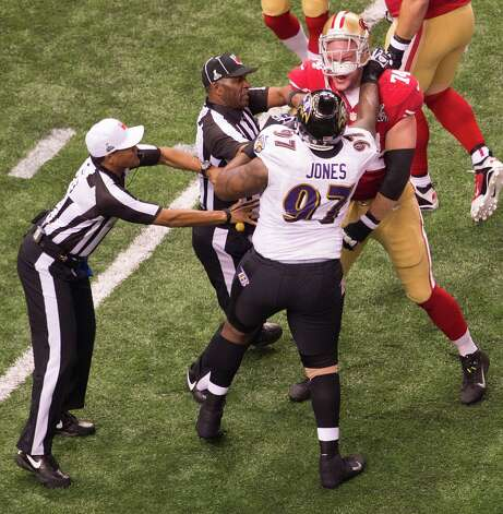 Officials reach in to separate San Francisco 49ers tackle Joe Staley (74) from Baltimore Ravens defensive end Arthur Jones (97) as they scuffle during the first half of Super Bowl XLVII at the Mercedes-Benz Superdome on Sunday, Feb. 3, 2013, in New Orleans. Photo: Smiley N. Pool, Chronicle / ONLINE_YES