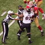 Officials reach in to separate San Francisco 49ers tackle Joe Staley (74) from Baltimore Ravens defensive end Arthur Jones (97) as they scuffle during the first half of Super Bowl XLVII at the Mercedes-Benz Superdome on Sunday, Feb. 3, 2013, in New Orleans.