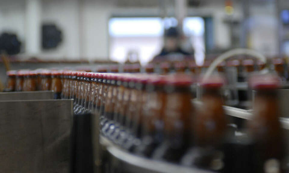 The bottling line inside the Alaskan Brewing Co., which has installed a unique boiler system that bu