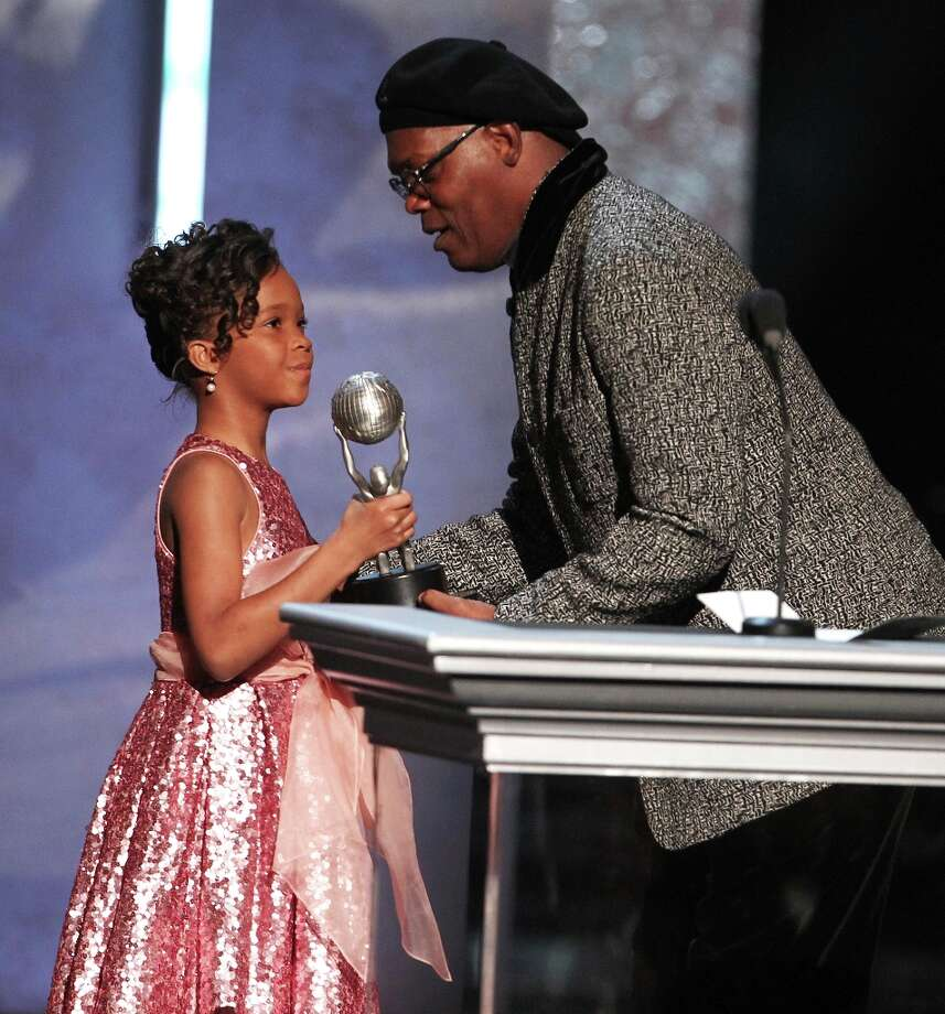 Quvenzhane Wallis, left, accepts the award for outstanding actress in a motion picture on behalf of Viola Davis for Won't Back Down from Samuel L. Jackson, at the 44th Annual NAACP Image Awards at the Shrine Auditorium in Los Angeles on Friday, Feb. 1, 2013. (Photo by Matt Sayles/Invision/AP) Photo: Matt Sayles, Associated Press / Invision