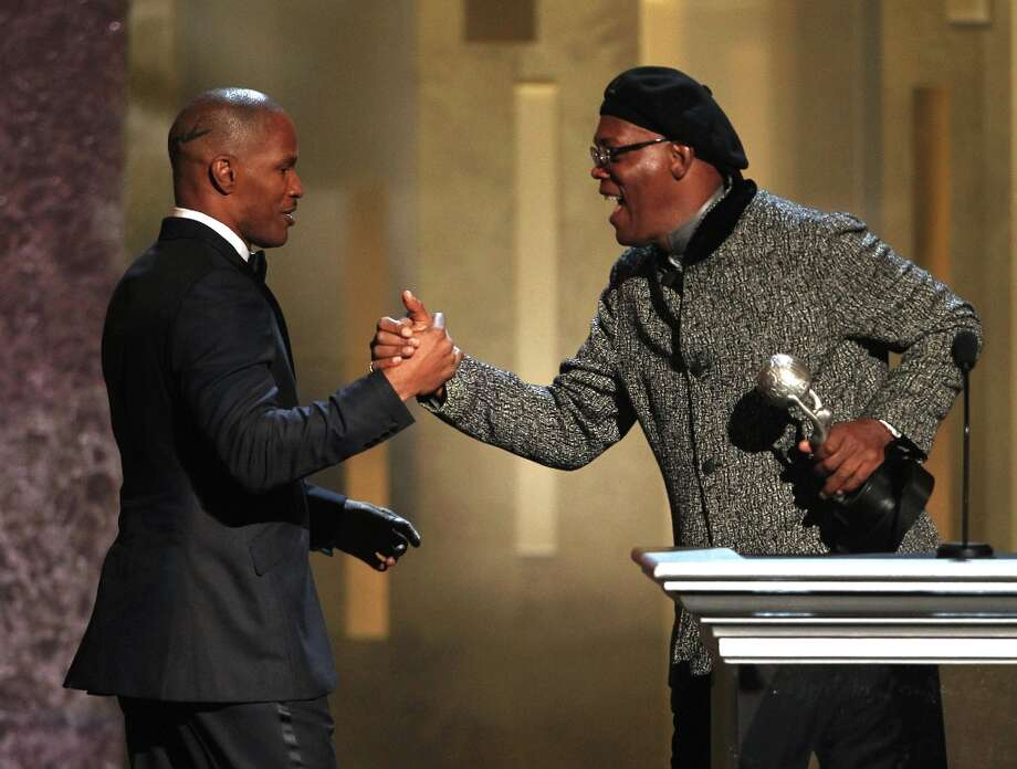 Samuel L. Jackson, right, presents the award for entertainer of the year to Jamie Foxx at the 44th Annual NAACP Image Awards at the Shrine Auditorium in Los Angeles on Friday, Feb. 1, 2013. (Photo by Matt Sayles/Invision/AP) Photo: Matt Sayles, Associated Press / Invision