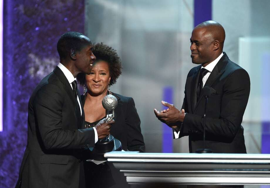 Actor Don Cheadle (L) accepts Outstanding Actor in a Comedy Series award for 'House of Lies' from TV personalities Wanda Sykes and Wayne Brady onstage during the 44th NAACP Image Awards at The Shrine Auditorium on February 1, 2013 in Los Angeles, California.  (Photo by Kevin Winter/Getty Images for NAACP Image Awards) Photo: Kevin Winter, (Credit Too Long, See Caption) / 2013 Getty Images