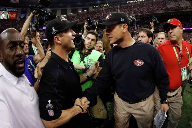 Head coach John Harbaugh of the Baltimore Ravens shakes hands with his brother head coach Jim Harbaugh of the San Francisco 49ers after winning Super Bowl XLVII at the Mercedes-Benz Superdome on February 3, 2013 in New Orleans, Louisiana. The Ravens defeated the 49ers 34-31. Photo: Ezra Shaw, Getty Images / 2013 Getty Images