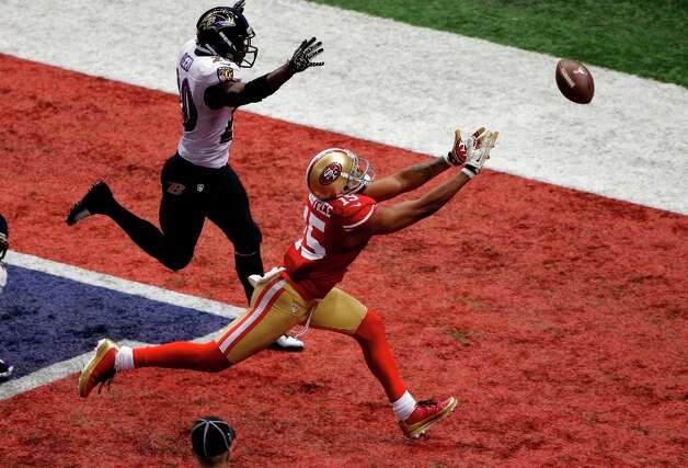 San Francisco 49ers wide receiver Michael Crabtree (15) cannot reach a pass thrown on fourth-and-goal as Baltimore Ravens safety Ed Reed (20) defends late in the fourth quarter of the NFL Super Bowl XLVII football game, Sunday, Feb. 3, 2013, in New Orleans. Photo: Charlie Riedel, Associated Press / AP