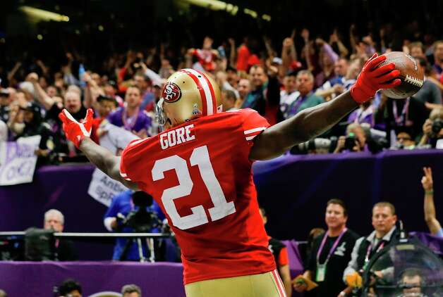 San Francisco 49ers running back Frank Gore (21) reacts after scoring a touchdown against the Baltimore Ravens during the second half of the NFL Super Bowl XLVII football game Sunday, Feb. 3, 2013, in New Orleans. (AP Photo/Julio Cortez) Photo: Julio Cortez, Associated Press / AP