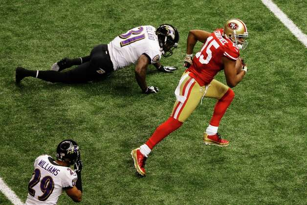 NEW ORLEANS, LA - FEBRUARY 03:  Michael Crabtree #15 of the San Francisco 49ers runs into the endzone on a 31-yard touchdown reception in the third quarter against Bernard Pollard #31 of the Baltimore Ravens during Super Bowl XLVII at the Mercedes-Benz Superdome on February 3, 2013 in New Orleans, Louisiana. Photo: Rob Carr, Getty Images / 2013 Getty Images