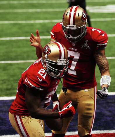 NEW ORLEANS, LA - FEBRUARY 03:  (L-R) Frank Gore #21 and Colin Kaepernick #7 of the San Francisco 49ers celebrate after Gore scored a 6-yard rushing touchdown in the third quarter against the Baltimore Ravens during Super Bowl XLVII at the Mercedes-Benz Superdome on February 3, 2013 in New Orleans, Louisiana. Photo: Win McNamee, Getty Images / 2013 Getty Images