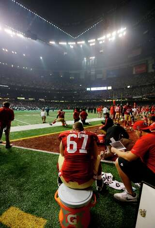 San Francisco 49ers offensive lineman Daniel Kilgore (67) waits on the bench during a power outage during the second half of the NFL Super Bowl XLVII football game Sunday, Feb. 3, 2013, in New Orleans. Photo: Darron Cummings, Associated Press / AP