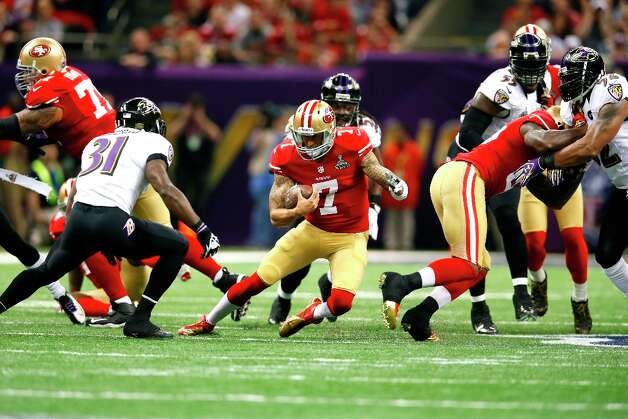 Quarterback Colin Kaepernick (7) breaks away for a run in the first half of Superbowl XLVII between the San Francisco 49ers and the Baltimore Ravens at the Mercedes-Benz Superdome on Sunday February 3, 2013 in New Orleans, La. Photo: Michael Macor, The Chronicle / SFC