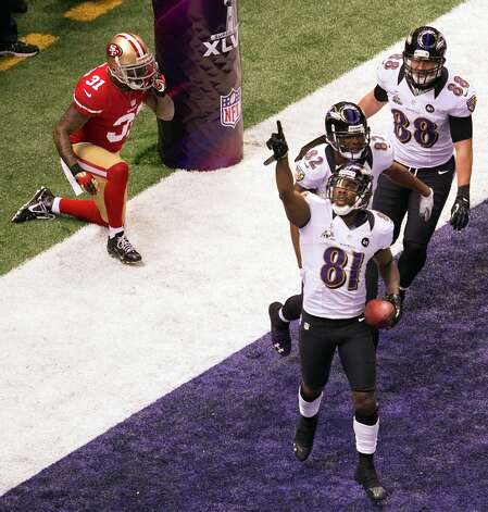 Baltimore Ravens wide receiver Anquan Boldin (81) celebrates after scoring on a 13-yard touchdown pass from Joe Flacco past San Francisco 49ers strong safety Donte Whitner (31) during the first quarter of Super Bowl XLVII at the Mercedes-Benz Superdome on Sunday, Feb. 3, 2013, in New Orleans. Photo: Smiley N. Pool, Chronicle / © 2013  Houston Chronicle
