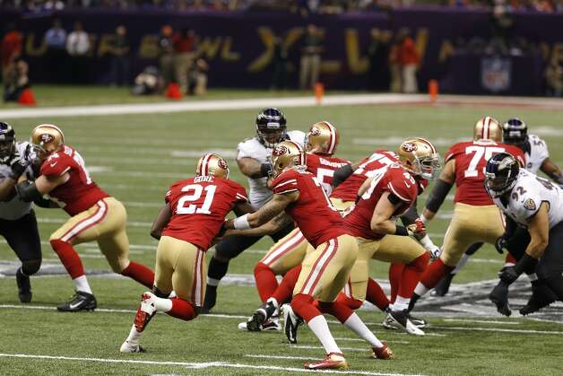 Quarterback Colin Kaepernick (7) hands off to Running back Frank Gore (21) during the first quarter of Superbowl XLVII between the San Francisco 49ers and the Baltimore Ravens at the Mercedes-Benz Superdome on Sunday February 3, 2013 in New Orleans, La. Photo: Carlos Avila Gonzalez, The Chronicle / ONLINE_YES