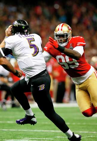 Linebacker Aldon Smith (99) sacks Baltimore Ravens quarterback Joe Flacco (5) during the first half of Superbowl XLVII between the San Francisco 49ers and the Baltimore Ravens at the Mercedes-Benz Superdome on Sunday February 3, 2013 in New Orleans, La. Photo: Michael Macor, The Chronicle / SFC
