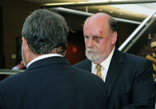 A september trial was set Monday for Beaumont attorney Kip Lamb who allegedly siphoned $1 million from a church's trust fund. Lamb talks to his attorney Mike Cichowski at the Jefferson County Courthouse on Monday. Photo taken Monday, July 9, 2012 Guiseppe Barranco/The Enterprise Photo: Guiseppe Barranco, STAFF PHOTOGRAPHER / The Beaumont Enterprise