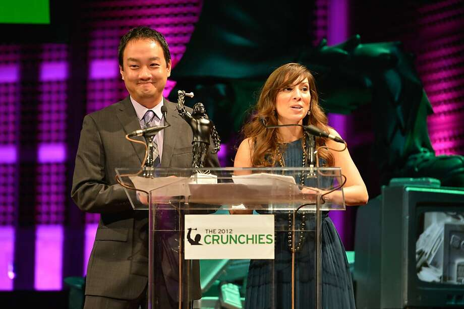 "Dan ""Shoe"" Hsu and Leah Busque (L-R) present award at the 6th Annual Crunchies Awards at Davies Symphony Hall in San Francisco, California. Photo: Steve Jennings, Getty Images For The Crunchies"