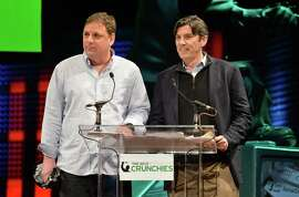 TechCrunch founder Michael Arrington (left) and AOL's Tim Armstrong present at the Crunchies Awards in 2013. The tech news site is part of AOL.