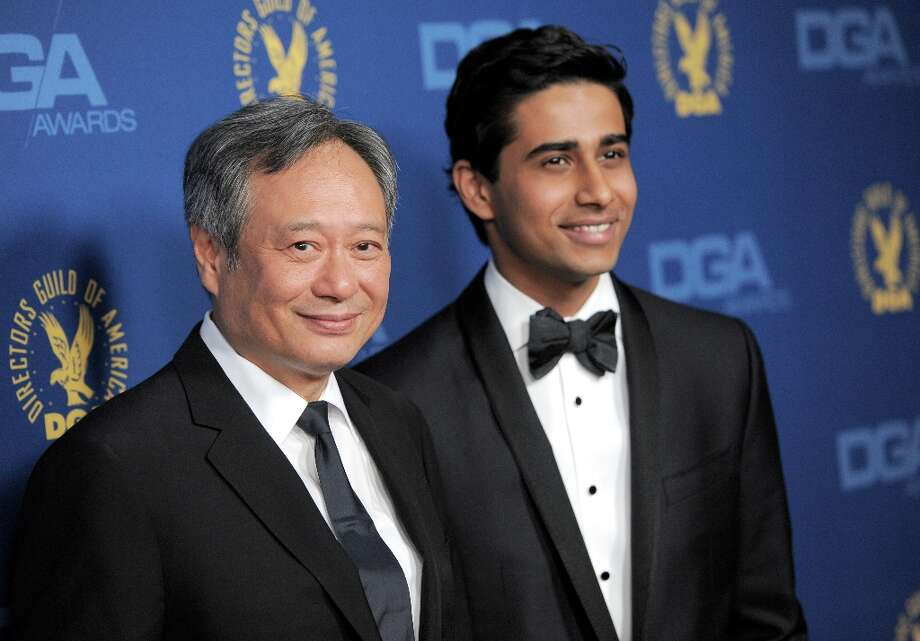 Ang Lee, left, and Suraj Sharma arrive at the 65th Annual Directors Guild of America Awards at the Ray Dolby Ballroom on Saturday, Feb. 2, 2013, in Los Angeles. (Photo by Chris Pizzello/Invision/AP) Photo: Chris Pizzello, Associated Press / Invision