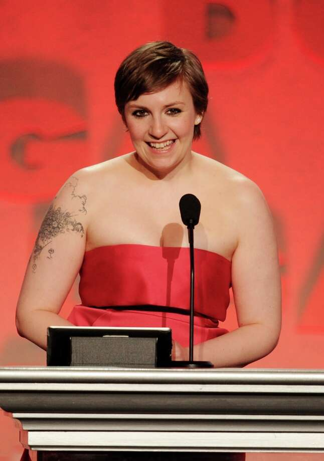 Actor/director Lena Dunham accepts the Outstanding Directorial Achievement in Comedy Series for 2012 award for Girls pilot episode onstage during the 65th Annual Directors Guild Of America Awards at Ray Dolby Ballroom at Hollywood & Highland on February 2, 2013 in Los Angeles, California. Photo: Kevin Winter, Getty Images / 2013 Getty Images