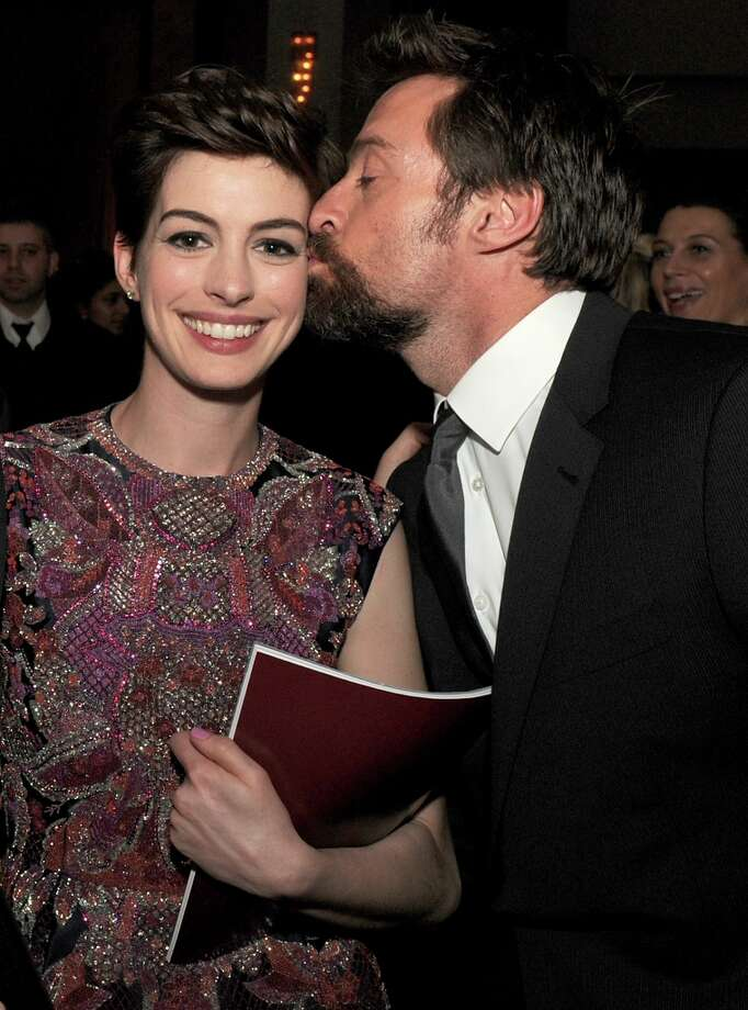 Actor Hugh Jackman (R) kisses actress Anne Hathaway during the 65th Annual Directors Guild Of America Awards at Ray Dolby Ballroom at Hollywood & Highland on February 2, 2013 in Los Angeles, California. Photo: Kevin Winter, Getty Images / 2013 Getty Images