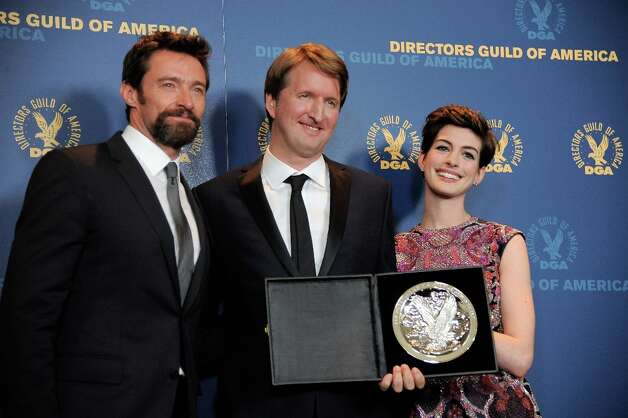 Director Tom Hooper, center, poses backstage with his outstanding directorial achievement  in feature film nomination plaque for Les Miserables with actors Hugh Jackman, left, and Anne Hathaway, right at the 65th Annual Directors Guild of America Awards at the Ray Dolby Ballroom on Saturday, Feb. 2, 2013, in Los Angeles. (Photo by Chris Pizzello/Invision/AP) Photo: Chris Pizzello, Associated Press / Invision