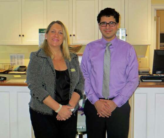 Marcelo Pena, who is completing his first year as a teller at the Bank of New Canaan's Elm Street branch, tells of his success through Future 5, in partnership with Stamford Public Schools, a nonprofit youth development organization based in Stamford. With him is Elizabeth Buzzeo, manager of the bankís 156 Cherry St. branch. Photo: Contributed